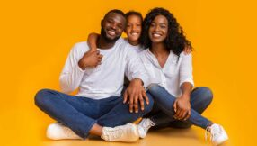image of black family smiling