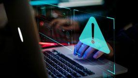Image of hands on computer fraud alert