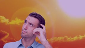 photo of man looking confused with sun behind him